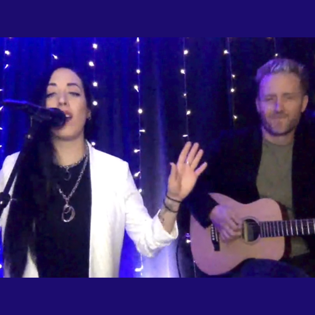 Kat Perkins on left sings song during Global Genes RARE Champion of Hope