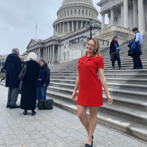 Taylor Kane stands in front of Capitol Building in Washington D.C.